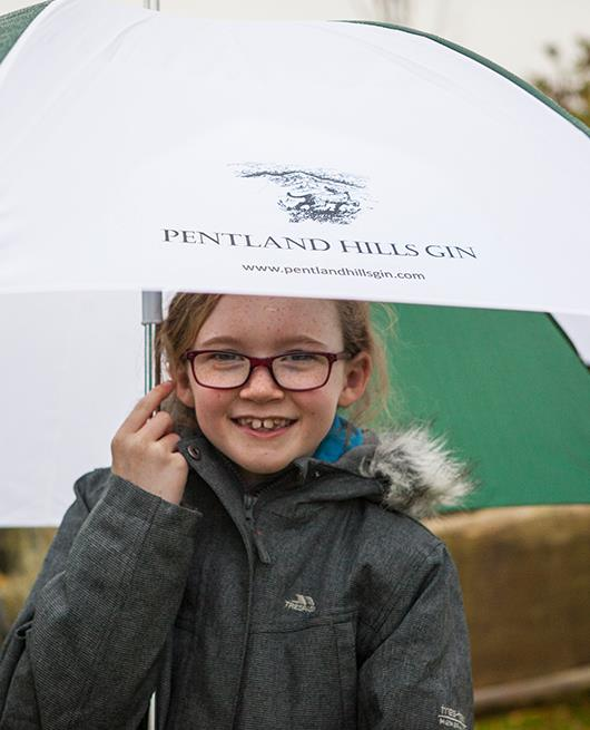 Child With Branded Umbrella - Pentland Hills Gin